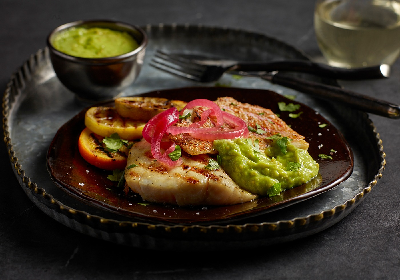GRILLED RED SNAPPER WITH AVOCADO & TOMATILLO SALSA on plate
